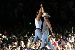 Tim McGraw & Kenny Chesney. Tim McGraw & Kenny Chesney perform live in Chicago for the Brothers of the Sun Tour Royalty Free Stock Images