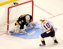 Tim Thomas makes save against Martin Erat. Stock Photos