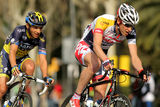 Tim Wellens and Karsten Kroon. Tim Wellens(R) and Karsten Kroon(L) ride during the Tour of Catalonia cycling race through the roads of Monjuich mountain in Stock Image