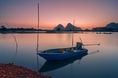 Timah Tasoh Lake, Perlis. Fisherman boat at Timah Tasoh lake in the morning during low tide season Stock Images