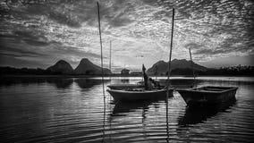 Timah Tasoh Lake, Perlis. Fisherman boats at Timah Tasoh lake in the morning during low tide season Royalty Free Stock Photography