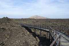 Timanfaya lava flow. Platform at rear of Timanfaya visitors centre, Lanzarote permits view of the extensive lava flow Stock Images