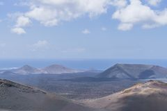 Timanfaya National Park.Ocean in Backgrounds Stock Photos