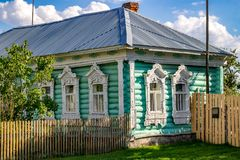 Timashovo, Russia - August 2018: Old village log house with beautiful carved platbands stock image