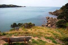 Timber bench sea bay view Royalty Free Stock Photo
