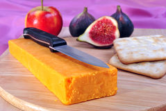 Timber board with organic cheddar cheese Royalty Free Stock Photo