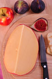 Timber board with organic gouda cheese Royalty Free Stock Photo
