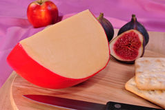 Timber board with organic gouda cheese Stock Images