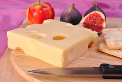 Timber board with some emmental cheese Royalty Free Stock Image