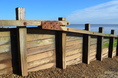 Timber Breakwater on Beach Royalty Free Stock Images