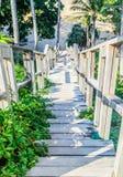 Timber bridge to the beach Stock Photo