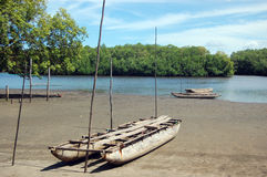 Timber canoe at river coast. Timber canoe ar river coast, Papua New Guinea Stock Images