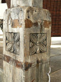 Timber column. Old handcrafted in new hotel Stock Photos
