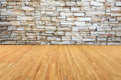 Timber decking connect to old grey stone wall Stock Image