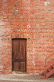 Timber door in red brick building Royalty Free Stock Images