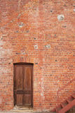 Timber door in red brick building Stock Photo