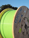 Timber drum with green fiber fiber optic cable for Tasmania Stock Images