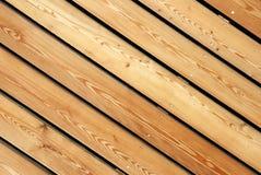 Timber facing. Diagonal tiling wood fence texture royalty free stock image
