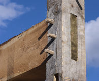 Timber Frame Barn Post and Beam Joint with Wooden Pegs. Detail of a timber frame joint showing the peg ends or trenails and the end of the tenon Stock Photography