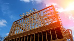 Timber frame house, new build roof with wooden home construction framing. Timber frame house, new build roof with wooden truss, post and beam framework home stock images