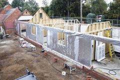 Timber frame house. Under construction with foil thermal insulation royalty free stock photography