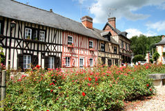 Timber Framed Houses. Row of Timber Framed Houses in an Historic Village in Normandy, France with colourful Flowers in the foreground Royalty Free Stock Photo