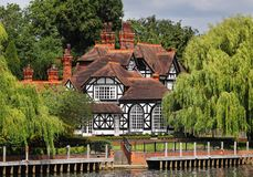 Timber framed  Riverside House and garden Royalty Free Stock Images