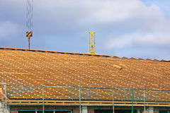 Timber framed roof 1. A timber framed roof on a construction site Stock Photos