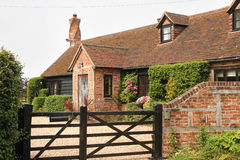 Timber Framed Village Cottage. Traditional Timber Framed English Village Cottage and garden with five bar gate and unusual Chimney Stock Photos