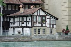 Timber framing house on Aare river at Berne. Switzerland royalty free stock photos