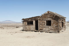 Timber home on arid landscape Stock Images