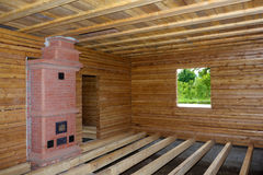Timber house interior with oven and  floor balks under construction Royalty Free Stock Image