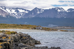 Timber house in Island and mountains view in Beagle Channel - Ushuaia, Tierra del Fuego, Argentina Stock Images