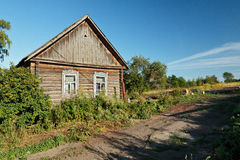 Timber house in Russian countryside near unsurfaced road Stock Photos