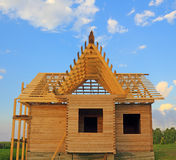 Timber house under constructoin with roof frame front view Royalty Free Stock Photos