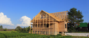 Timber house under constructoin with roof frame Stock Images