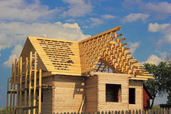 Timber house under constructoin with roof frame Royalty Free Stock Photography