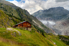 Timber hut with Aletsch glacier Stock Photography