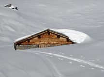 Timber hut covered by snow Royalty Free Stock Images