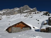 Timber hut and mountain Stock Photography