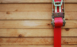 Timber with lashing strap Royalty Free Stock Images