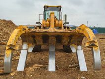 Timber loader on the loading dock closeup. Front view Stock Photography