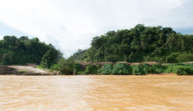 Timber logging site along Sarawak Rejang river. Timber logging camp along Sarawak Rejang river, Malaysia Stock Photo