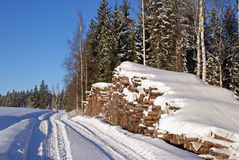 Timber Logs By Forest Road In Winter Royalty Free Stock Images