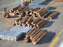 Timber logs on the dock. Timber logs import on the docks in a commercial harbor stock image