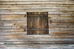 Timber made hatch in a wooden wall Stock Images