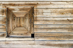 Timber made hatch in a wooden wall. Timber made hatch in an old wooden wall Royalty Free Stock Image