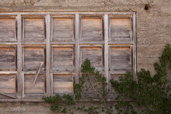 Timber panel in concrete wall Stock Photos