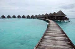 Timber pathway to bungalow at Thulhagiri Island Stock Photography