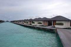 Timber pier with bungalow at island resort Maldives Stock Images